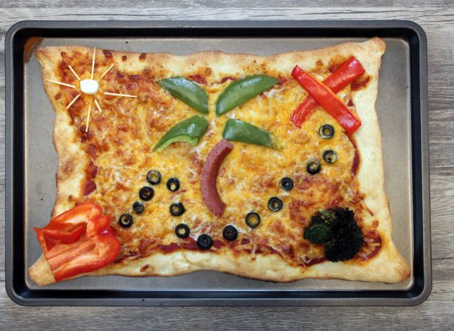 A pizza decorated to look like a treasure map