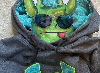 photo of a portrait of a stuffed animal wearing a sweater