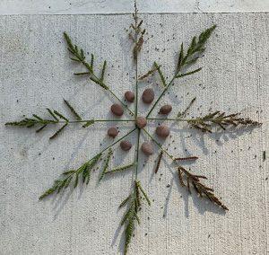 Nature Mandala made out of long grass and rocks