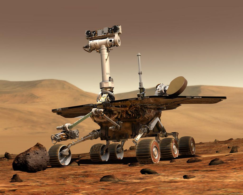 An artist concept portrays a NASA Mars Exploration Rover on the surface of Mars.